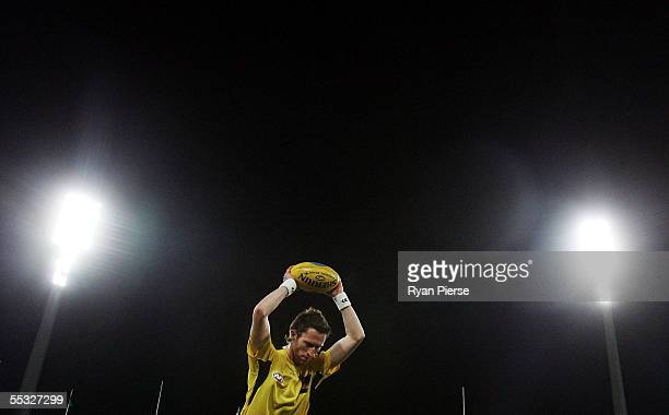 Umpire Shaun Ryan warms up before the AFL Semi Final match between the Sydney Swans and the Geelong Cats at the SCG September 9 2005 in Sydney...
