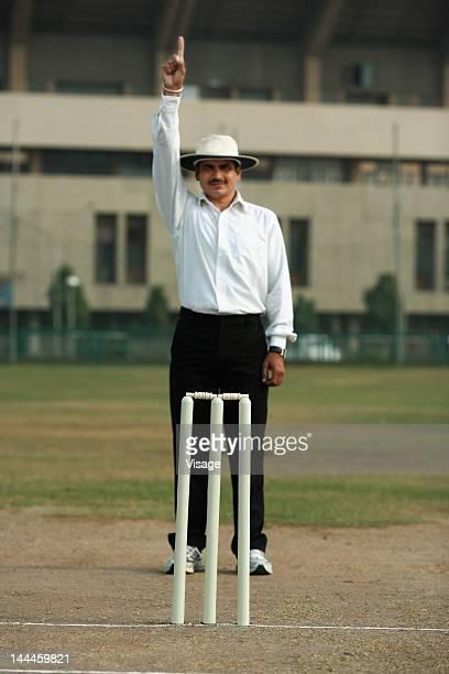 Umpire signaling out, Cricket