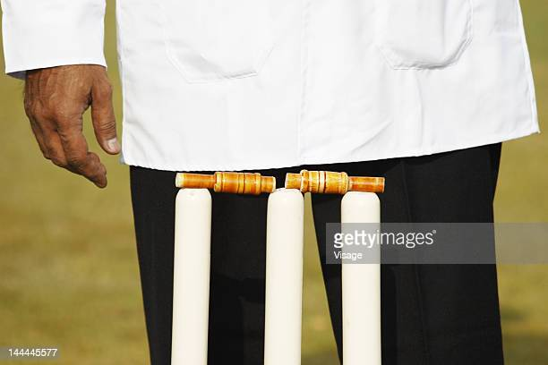 Umpire standing behind the stumps