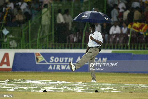 Umpire Steve Bucknor checks the conditions as rain stopped play during the rescheduled ICC Champions Trophy final between Sri Lanka and India at the...