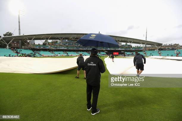 Umpire Sundaram Ravi overseens the groundstaff as rain suspends play during the ICC Champions Trophy Group A match between Australia and Bangladesh...
