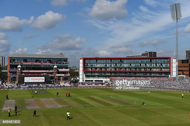 Umpire Tim Robinson and match officials make an inspection as a wet outfield delays the start of the first OneDay International cricket match between...