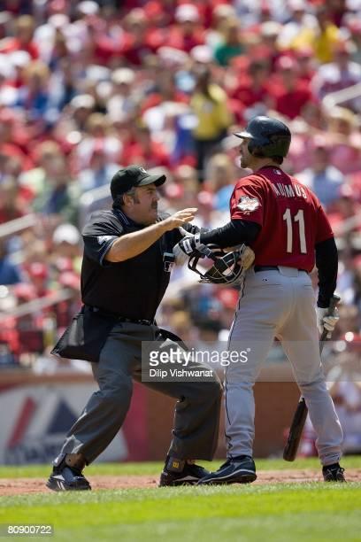 MLB umpire Tim Tschida restrains Brad Ausmus of the Houston Astros against the St Louis Cardinals on April 26 2008 at Busch Stadium in St Louis...