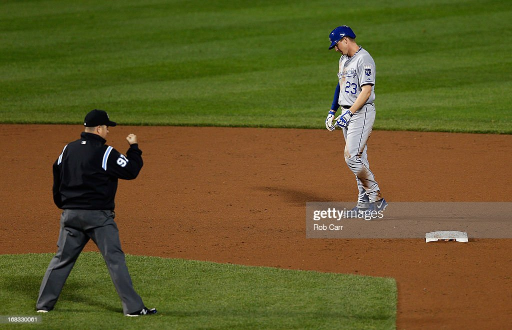 Umpire Todd Tichenor calls out Elliot Johnson #23 of the Kansas City Royals after being forced out at second base in the ninth inning of the Royals 5-3 loss to the Baltimore Orioles at Oriole Park at Camden Yards on May 8, 2013 in Baltimore, Maryland.