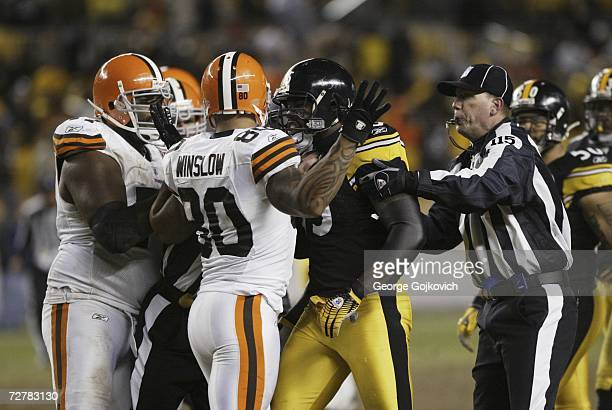 Umpire Tony Michalek tries to hold back linebacker Joey Porter of the Pittsburgh Steelers as Porters confronts tight end Kellen Winslow of the...