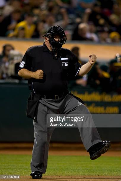 MLB umpire Wally Bell calls a third strike during the second inning between the Oakland Athletics and the Minnesota Twins at Oco Coliseum on...