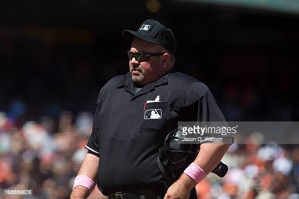 MLB umpire Wally Bell stands behind home plate during the sixth inning between the San Francisco Giants and the Atlanta Braves at ATT Park on May 12...