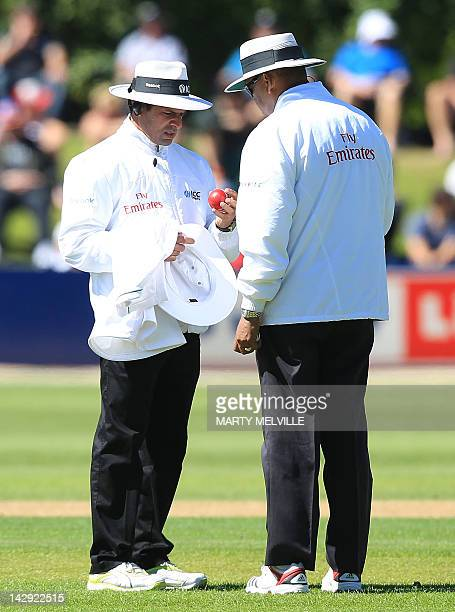 Umpirers Aleem Dar and BR Doctrove check the match ball during day two of the first five day international cricket test match between New Zealand and...