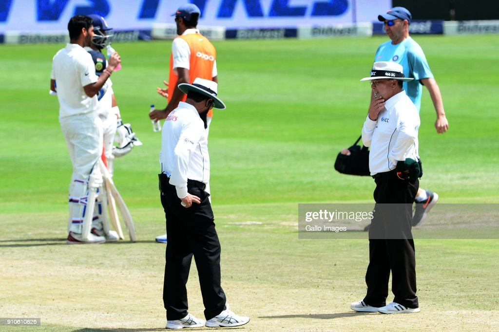Umpires, Aleem Dar and Ian Gould inspect the pitch during day 3 of the 3rd Sunfoil Test match between South Africa and India at Bidvest Wanderers Stadium on January 26, 2018 in Johannesburg, South Africa.