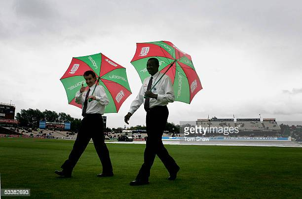 Umpires Billy Bowden and Steve Bucknor inspect the pitch during a rain delay on day three of the Third npower Ashes Test match between England and...