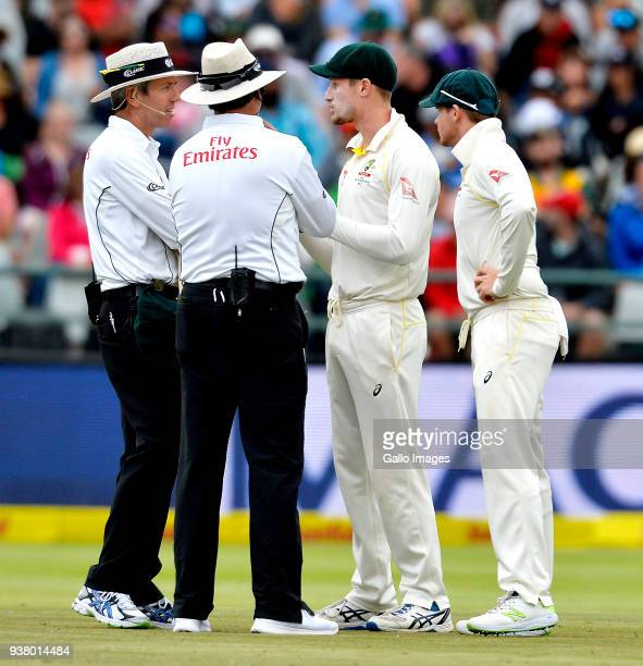Umpires chatting with Cameron Bancroft and Steven Smith of Australia during day 3 of the 3rd Sunfoil Test match between South Africa and Australia at...
