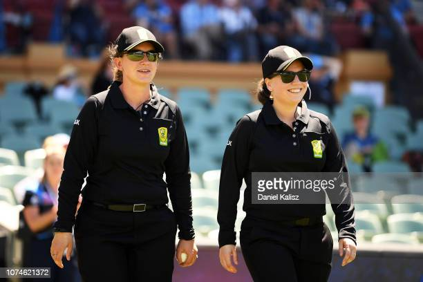 Umpires Claire Polosak and Eloise Sheridan walk onto the ground during the Adelaide Strikers v Melbourne Stars Women's Big Bash League Match at...