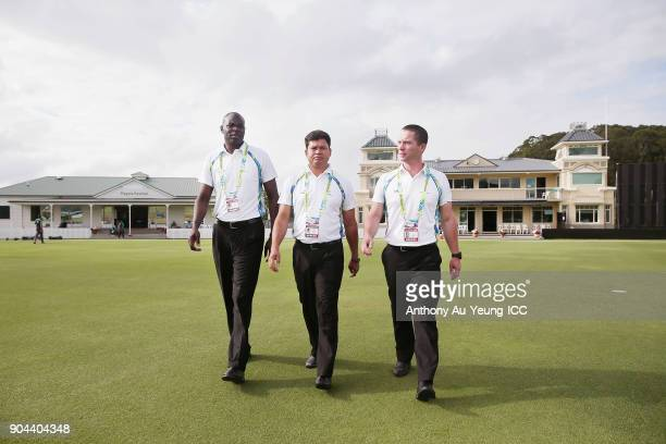 Umpires David Agutu Buddhi Pradhan and Shaun Haig walk out to inspect the pitch prior to the ICC U19 Cricket World Cup match between Pakistan and...
