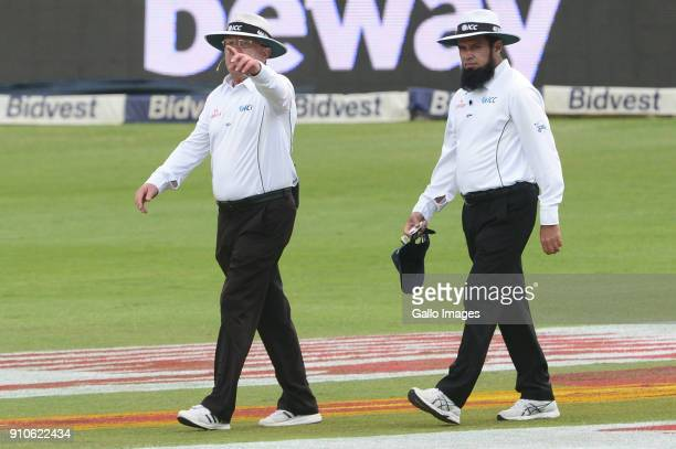 Umpires Ian Gould and Aleem Dar sends the players off the field during day 3 of the 3rd Sunfoil Test match between South Africa and India at Bidvest...