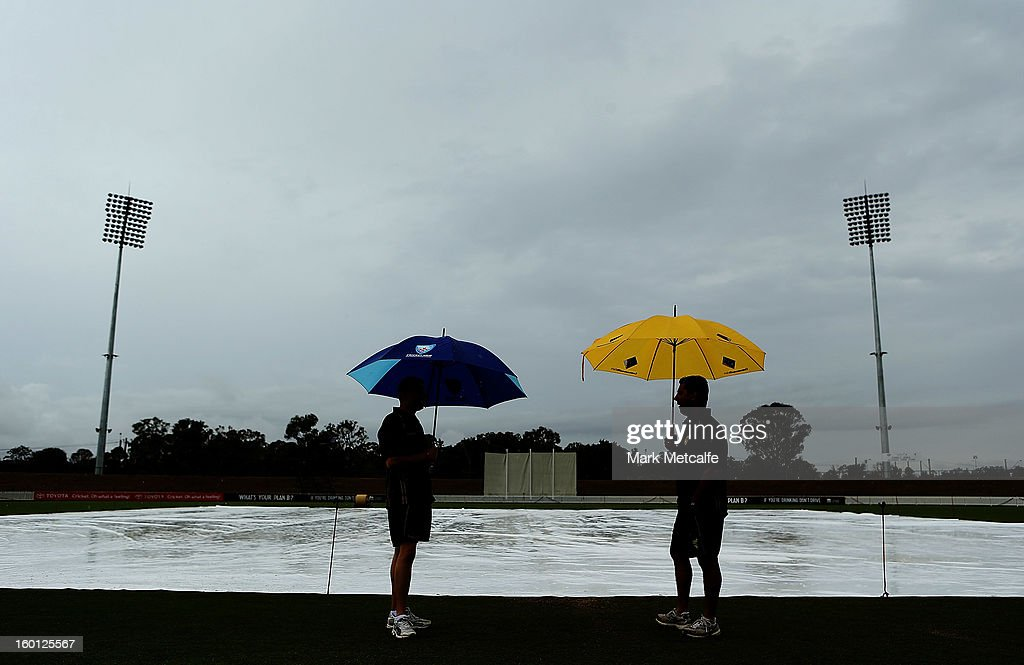 Umpires inspect the ground as rain delays the start of day four of the Sheffield Shield match between the New South Wales Blues and the Western Australia Warriors at Bankstown Oval on January 27, 2013 in Sydney, Australia.