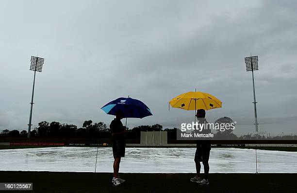 Umpires inspect the ground as rain delays the start of day four of the Sheffield Shield match between the New South Wales Blues and the Western...