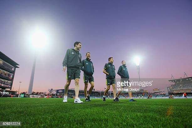 Umpires inspect the ground conditions during the round six AFL match between the Geelong Cats and the Gold Coast Suns at Simonds Stadium on April 30...