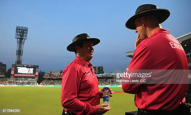 Umpires Johan Cloete and Michael Gough look on after a floodlight fails during the ICC World Twenty20 India 2016 match between Bangladesh and New...