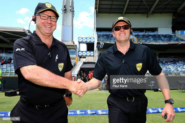 Umpires John Taylor and James Hewitt take to the field during the Women's Big Bash League match between the Melbourne Stars and the Perth Scorchers...