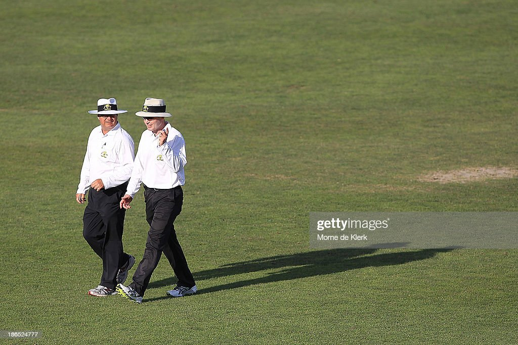 Umpires John Ward and Simon Fry leave the field after day three of the Sheffield Shield match between the South Australia Redbacks and the Queensland Bulls at Glenelg Oval on November 1, 2013 in Adelaide, Australia.