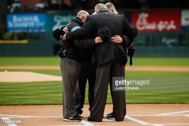Umpires Lance Barksdale Ryan Blakney Ted Barrett and Nic Lentz come together for a private moment on the field before a game between the San...