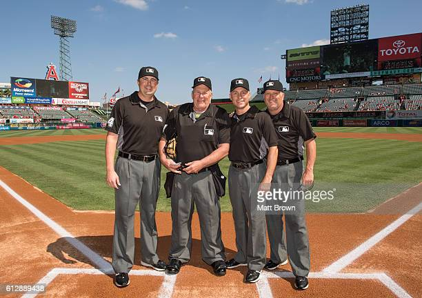 Umpires Lance Barrett Bob Davidson Dan Iassogna and Dale Scott pose at home plate before the game between the Houston Astros and the Los Angeles...