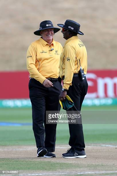 ICC umpires Mark Hawthorne and Ranmore Martinesz chat during the ICC U19 Cricket World Cup 5th Playoff match between South Africa and Bangladesh at...
