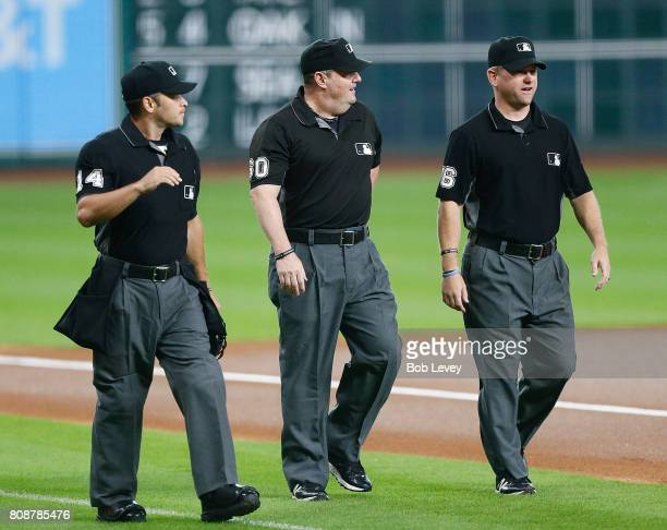 Umpires Mark WegnerMarty Foster and Mike Muchlinski take the field at Minute Maid Park on June 30 2017 in Houston Texas
