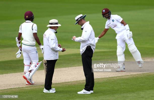 Umpires Michael Gough and Richard Illingworth sanitise the ball after saliva is accidentally added to it during Day Four of the 2nd Test Match in the...