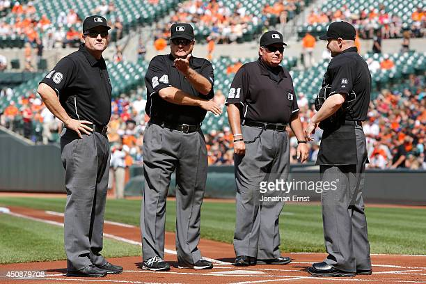 Umpires Mike DiMuro Jerry Layne Hunter Wendelstedt and Mike Estabrook take the field before the start of a game between the Toronto Blue Jays and the...
