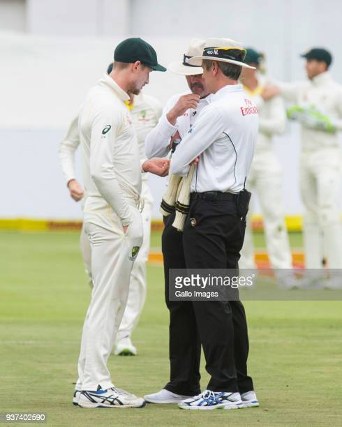 Umpires Nigel Llong and Richard Illingworth confront Australia's Cameron Bancroft during day 3 of the 3rd Sunfoil Test match between South Africa and...