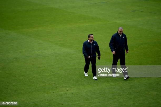 Umpires Paul Baldwin and Michael Gough walk inspect the field as rain delays the start of play on day three of the Specsavers County Championship...