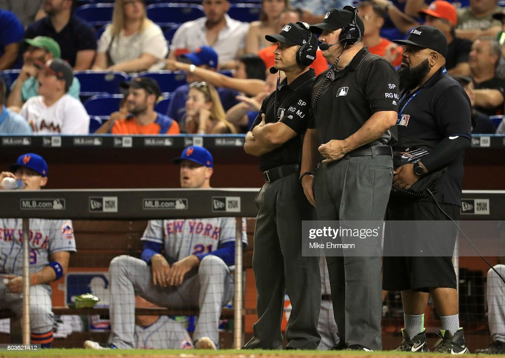 Umpires Ryan Blakney and Marty Foster go over a replay during a game between the Miami Marlins and the New York Mets at Marlins Park on June 29, 2017 in Miami, Florida.