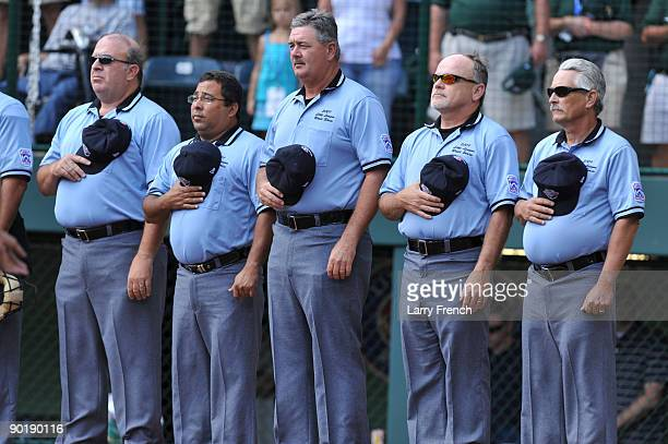 Umpires stand for the national anthem before the game between California and Asia Pacific in the little league world series final at Lamade Stadium...