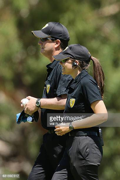 Umpires Todd Rann and Ashlee Kovalevs go to change the match ball during the Women's Big Bash League match between the Adelaide Strikers and the...