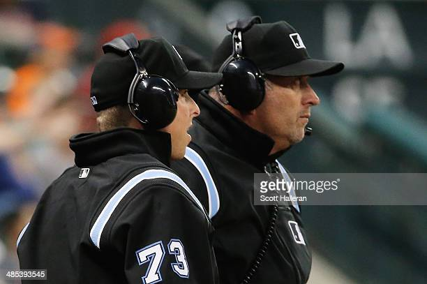 MLB umpires Tripp Gibson and Dale Scott review a play in the second inning of the game between the Kansas City Royals and Houston Astros at Minute...