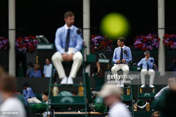 Umpires watch proceedings on the seventh day of the 2016 Wimbledon Championships at The All England Lawn Tennis Club in Wimbledon southwest London on...
