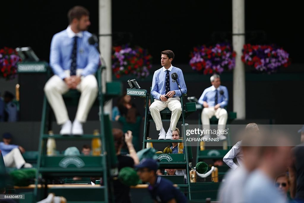 TOPSHOT - Umpires watch proceedings on the seventh day of the 2016 Wimbledon Championships at The All England Lawn Tennis Club in Wimbledon, southwest London, on July 3, 2016. / AFP / ADRIAN