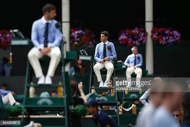 TOPSHOT Umpires watch proceedings on the seventh day of the 2016 Wimbledon Championships at The All England Lawn Tennis Club in Wimbledon southwest...