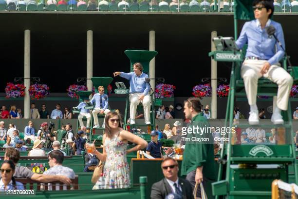 July 08: Umpires working on the outside courts during the Wimbledon Lawn Tennis Championships at the All England Lawn Tennis and Croquet Club at...