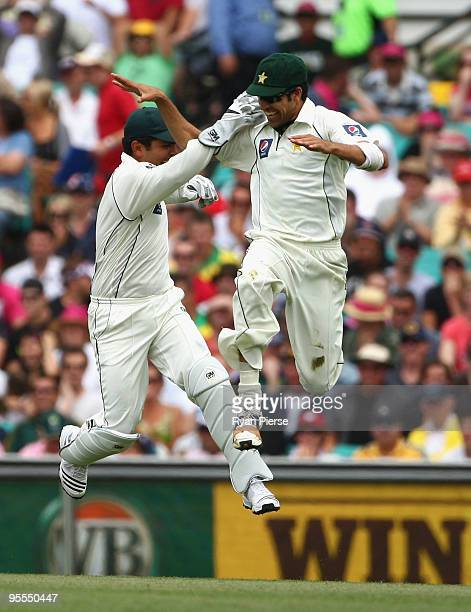 Umur Gul of Pakistan celebrates with Kamran Akmal of Pakistan after catching Ricky Ponting of Australia for a duck during day one of the Second Test...
