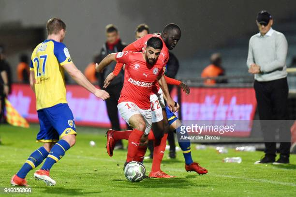 Umut Bozok and Sada Thioub of Nimes during the French Ligue 2 match between Nimes and Sochaux at Stade des Costieres on April 13 2018 in Nimes France