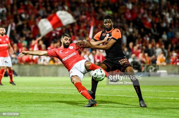 Umut Bozok of Nimes and Ibrahima Conte of Lorient during the French Ligue 2 match between Nimes and Lorient at Stade des Costieres on April 24 2018...
