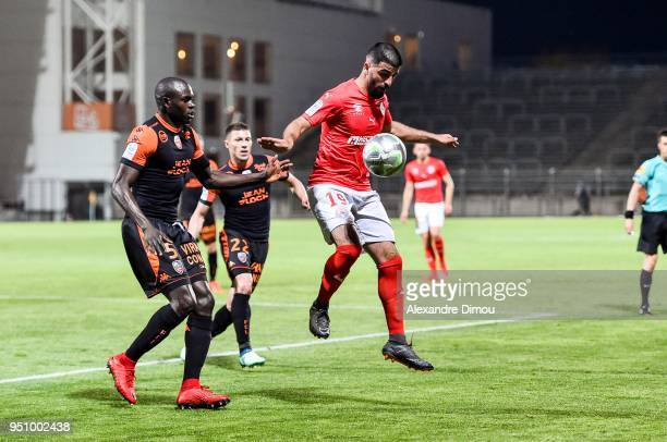 Umut Bozok of Nimes and Zargo Toure of Lorient during the French Ligue 2 match between Nimes and Lorient at Stade des Costieres on April 24 2018 in...
