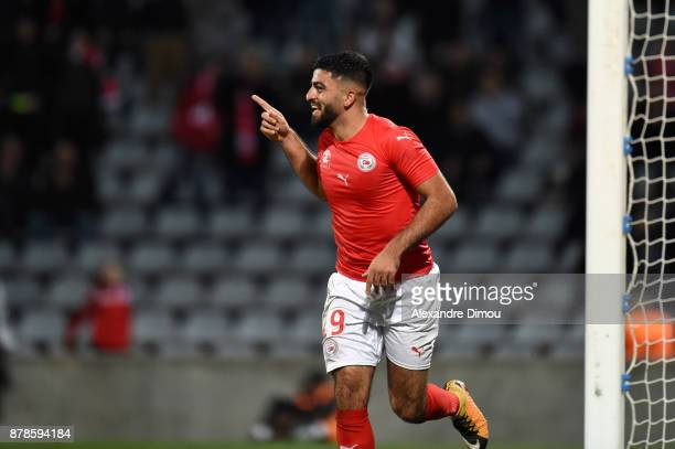 Umut Bozok of Nimes celebrates his second goal during the Ligue 2 match between Nimes and Bourg en Bresse at Stade des Costieres on November 24 2017...