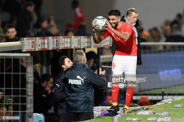 Umut Bozok of Nimes celebrates his third goal during the Ligue 2 match between Nimes and Bourg en Bresse at Stade des Costieres on November 24 2017...