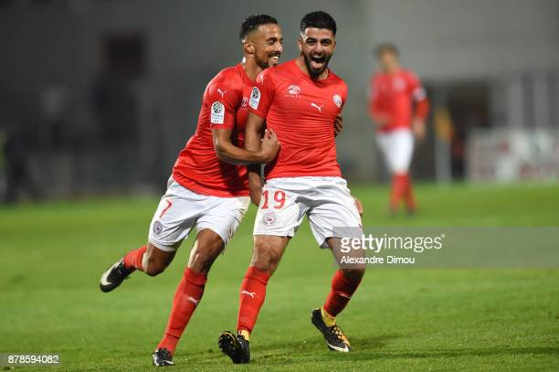 Umut Bozok of Nimes celebrates his third goal with Rachid Alioui during the Ligue 2 match between Nimes and Bourg en Bresse at Stade des Costieres on...