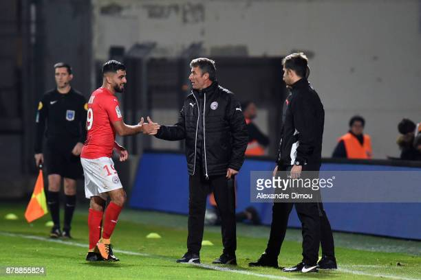 Umut Bozok of Nimes celebrates one Goal with Bernard Blaquart Coach of Nimes during the Ligue 2 match between Nimes and Bourg en Bresse at Stade des...