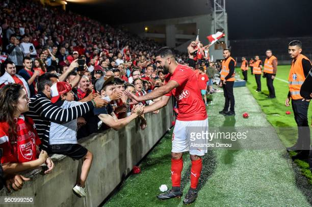Umut Bozok of Nimes celebrates the Victory with Fans during the French Ligue 2 match between Nimes and Lorient at Stade des Costieres on April 24...