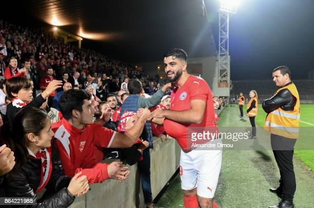 Umut Bozok of Nimes celebrates the Victory with Fans during the Ligue 2 match between Nimes Olympique and Stade Brestois at on October 20 2017 in...